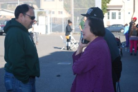 Fremont Principal Emiliano Sanchez (left) talks to Oakland Mayor Jean Quan at the end of the Martin Luther King, Jr., Day of Service at Fremont on Monday, Jan. 20.