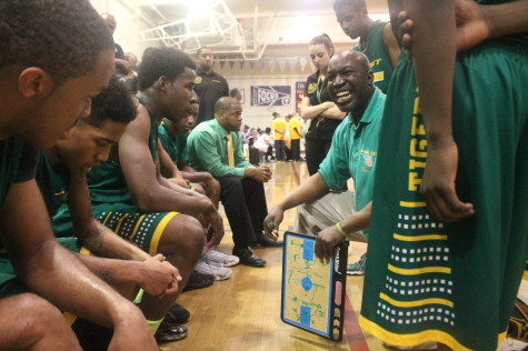 Coach Scot Alexander (second from right) gives his Tiger basketball players instructions on how to defeat the Oakland Tech Bulldogs. The Tigers did and will play the McClymonds Warriors today at 6 p.m. at Laney College for the Oakland Athletic League championship. The Tigers also have secured a spot in the first round of the CIF state playoffs.