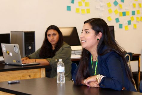 Nidya Baez, FHS '03 (right) speaking at a press conference about her experience as the new assistant principal of Fremont High School to the junior journalism students.